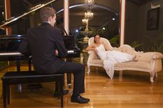 Wedding Photography at Bram Leigh Receptions groom playing piano for bride