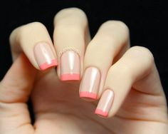 nude nails with coral french tips