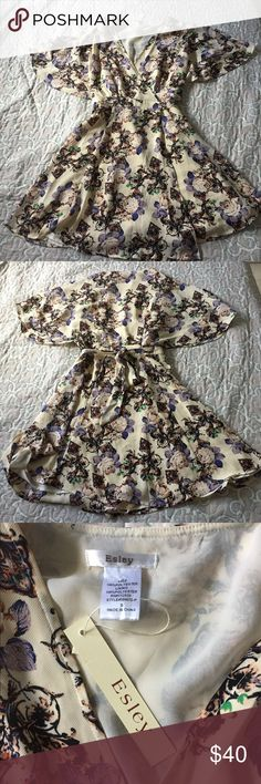 NWT Esley floral wrap dress boho butterfly sleeves Light and summery! New with tags. This is a wrap dress the ties in the back. Inner layer so it's not see through. Butterfly sleeves very flattering. Tags: Free People, Angie, Bohemian, wild fox, country chic Esley Dresses