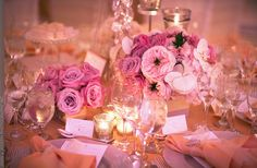Lavender and pink flowers with gold lighting and linens.