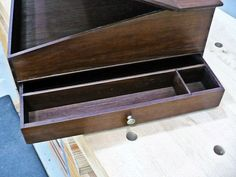 I like to make projects that fit in with my re-enacting & camping hobbies, so a couple of years ago I found some great plans for a Shaker Lap Desk & some beautiful Walnut lumber & was ready to build. Home Blogs, Dry Sand, Brass Tacks, Lap Desk, Tung Oil, Outdoor Signs, Backyard Bbq, Office Accessories, Writing Desk