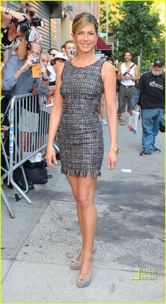 Jennifer Aniston/tweedy texture dress and dangle earrings.