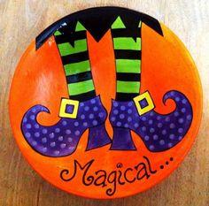 galets décoratifs à motif pieds d'un magicien Halloween sur fond orange