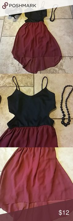 Womens szM high low side cut out dress so sexy This Womens size medium high low style dress with side cuts is a perfect mix for a super sexy style. The black top is cotton with spaghetti straps and thw bottom is silky rayon with a slip.  Great condition Dresses High Low