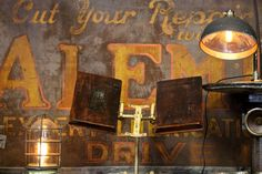 Signs, lamps, and book holders, all sealed with rust Book Holders, Rust, Lamps, Signs, Painting, Black, Lightbulbs, Black People, Shop Signs