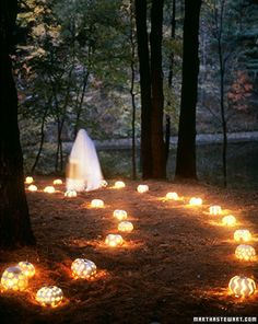 Pumpkin lit path - Decoratively punched pumpkins illuminate a path for trick-or-treaters.
