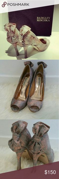 "Badgley Mischka Macee rose bow glitter heel sz6.5 This is a pair of  stunning heel party shoes featuring rose gold and gray glitter with a ribbon bow on the back. Heel is 4.5"". Size 6.5M. It is still in great condition only worn twice for wedding parties. Comes with original box. Paid original price at 235. Badgley Mischka Shoes Heels"