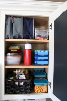Cabinet organizing for lunchbox station.  Lunchboxes, containers, thermos, and snacks all in one!  Love!  --- IHeart Organizing: Back To School Organization