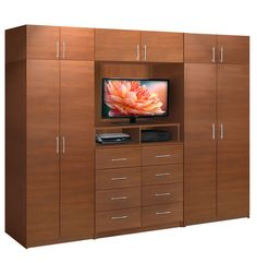 This bedroom wall unit offers more storage than any other in the Aventa Collection. At its heart there's space for a 42 inch TV, under which are shelving for video components. Wall Wardrobe Design, Wardrobe Wall, Wardrobe Interior Design, Wardrobe Door Designs, Bedroom Closet Design, Bedroom Furniture Design, Home Room Design, Closet Designs, Home Decor Furniture