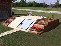 Cedar log landscape provide great flower beds for a storm cellar.