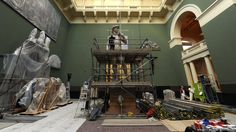 Johanna Puisto, sculpture conservator at The V&A, unveils a cast of Michelangelo's David at the museum