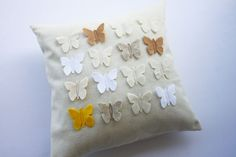 Felt pillowcase with felt butterflies. Butterflies, dinosaurs, flowers....anything like that would be great!