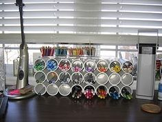 I don't know what copics are, but this would be a great idea for storing stabilizer.  i would turn it on its end (3 across the bottom) to save counter or desk space.  PVC pipe Copic storage