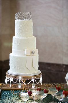40 Artsy Wedding Cakes #ideas #wedding #cake : Rhinestone Tiara Cake Topper on white tiered Wedding Cake - Gold Chandelier Cake Stand created by Opulent Treasures .... shop  here >> > https://www.opulenttreasures.com/shop/chandelier-loopy-band