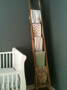 Vintage nursery- old ladder to hang baby blankets