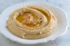 Smooth and Simple Hummus Recipe.  I needed a new hummus recipe and this one hit the spot (though I added a little more water and a bit more garlic and oil).  yum!