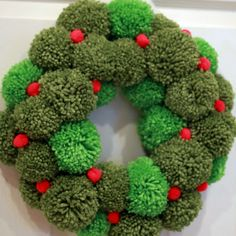 pom pom wreath - think of all the pretty color combos you could use :)