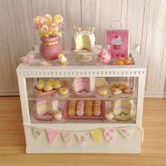 """Miniature Bakery Case Filled With All Things Pink And Yellow, 4 Cakes, Cookies, A """"So Very Sweet"""" Sign, A Pastel Bunting And More"""
