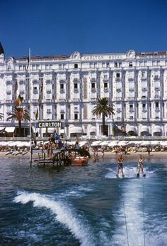 Title:Hotel Sports   Caption:1958: Holidaymakers water-skiing in front of the Carlton Hotel, Cannes.       Artist:Slim Aarons  Date:Circa: 1958