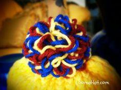 Loom Knit Pom Pom Video Tutorial from http://www.loomahat.com . An easy to do pom pom made on a Flower Loom