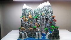 LEGO Ideas - The Hobbit-Rivendell. SOOOOOOOO Amazing. Once you see this you'll be amazed. THE WATER EVEN GLOWS!!! :O :D IF you have a LEGO Idea's account please support! :D :D :)