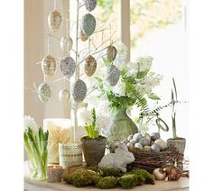 Sparkle Ornament Eggs // A little sparkle goes a long way toward creating a festive spring look. Hang these glittery eggs in any space you'd like to brighten, or use them to add a bit of shimmer to a vase.