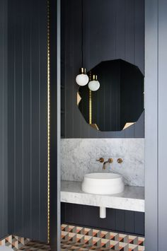 Hecker Guthrie Transform a Grand Victorian Residence. Blue bathroom with geometric tiles, marble counter