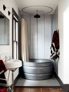 16 Creative Ways to Transform Your Home and Backyard with Stock Tanks During your next bathroom renovation, infuse some rustic flair into your bathroom by asking your contractor to install one of these beauties. See more at Stickett Inn. House Bathroom, Bathroom Inspiration, Small Bathroom, Bathrooms Remodel, Rustic Bathrooms, Bathroom Renovation, Rustic Shower, Bathroom Design, Rustic Bathtubs