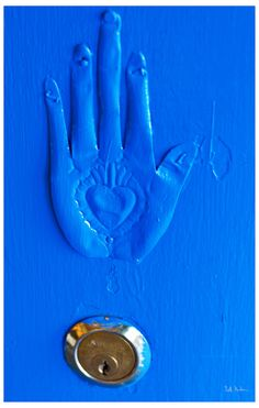 Mystical Blue Hand  Andersonville doorway    By swanksalot Seth Anderson