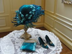 unknown artist - turquoise hat with ribbons and feathers; evening purse and shoes