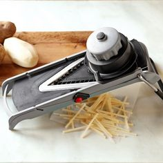 Mandoline: interchangeable blades for cubes, diamond cuts, julienne, strips, sticks, and rounds AND you can adjust the thickness of slices! Huge timesaver!
