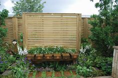 Garden bench with Jacksons Venetian fence panel, as part of the Green Connection show garden at BBC Gardeners' World Live 2016.