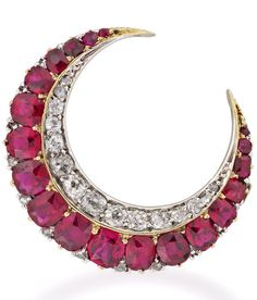 A Victorian ruby and diamond crescent brooch  A Victorian ruby and diamond crescent brooch, with one row of cushion-cut graduating rubies estimated to weigh approximately 3 carats and a row of graduating old brilliant-cut diamonds weighing approximately half a carat, all set in silver to a yellow gold mount with brooch fitting, circa 1880, gross weight 5.4 grams,