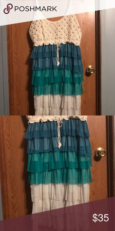 BoHo ruffled dress Layered ruffles colored in bluish green shades to cream. Topped of with a beautiful crochet top. Lots of comments on this dress. In great condition. Only wore one time for special occasion. Dresses