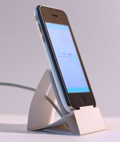 If you don't want to dish out the cash for a dock or stand that didn't come with your new Apple iPhone or iPod Touch, then consider making your own. At one time, especially when the iPhone first hit the stores, there was a craze that swept the web of. Diy Iphone Stand, Iphone Holder, Smartphone Holder, Iphone Charger, Ipod Touch, Tech Accessories, Cell Phone Accessories, Samsung Accessories, Walpaper Black