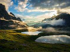 The sun rises over peaks and ponds on Tre Cime di Lavaredo (Three Peaks of Lavaredo), an iconic Alpine massif in northeastern Italy's Sexten Dolomites. The distinctive formations and their surroundings are a popular climbing and hiking destination. Photograph by Philippe Schwaller, National Geographic Your Shot, January 27, 2015