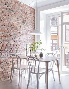 Bright and airy appartment with exposed brick wall and cute dining space