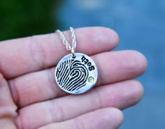 Oh my goodness, who wouldn't want their loved one's fingerprint on a silver necklace???