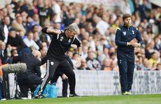 Tottenham manager Mauricio Pochettino (R) as West Brom manager Alan Irvine celebrates