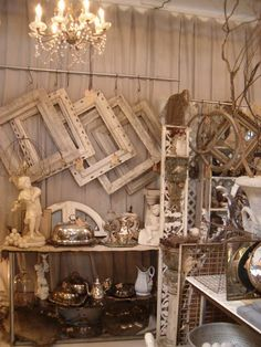 Silver and neutrals display ~ love the frame display