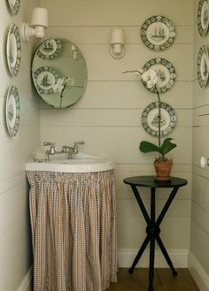 Vintage corner bathroom sink -- I don't love the skirt but I do love that it hides the plumbing.