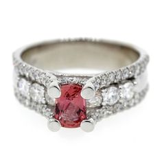 This beautiful ring is made with 18k white gold and carries a gorgeous 13 carat Cubic Zirconia gem with 62 surrounding round Diamonds with a total carat weight of 1.30.