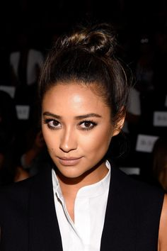 Shay Mitchell wore her hair up in an edgy top knot during the BCBG Max Azria fashion show.
