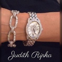 Judith Ripka Diamonique Watch NWOT Judith Ripka Stainless Steel Watch. 2.7 Carats Diamonique Gemstones + 3 Interchangeable Straps. Gemstone accents on oval case, dial & crown. Roman numerals 3, 6, 9 &12, gemstone markers at other hours. Hour, minute & second hands. Stainless Stella deployment clasp on stainless Stella bracelet strap; adjustable buckle closure on interchangeable leather straps. Water resistant to 3ATM. Swiss parts movement. Sapphire crystal face. Size average fits similar to…