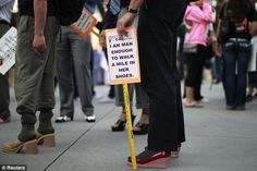 19/04/12, San Jose, California. Men wearing high heeled shoes turned out for the 10th annual 'Walk a Mile in Her Shoes' event to raise awareness of sexual violence against women.