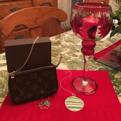 Authentic Louis Vuitton mini pochette Brand New Louis Vuitton Mini Bag. LV Code SF0163. 6 inches wide. 4 inches long. No tag or receipt. Comes with duster and box. PRICE IS FIRM. Louis Vuitton Bags Mini Bags