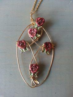 Hand Wire Wrapped Golden Rose Cross Necklace.This Photograph Copyright © Jeanette Roberts, The ArtFull Boutique 2015