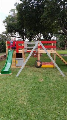 Colorful Pallet Jungle Gym – Kids Playhouse | 99 Pallets http://smallhousediy.com/category/building-a-playhouse/ #buildachildrensplayhouse