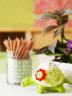 Get creative with your tools. Instead of using your typical boring pincushion, a stuffed green turtle that matches the room's bright color scheme helps bring the room to life./