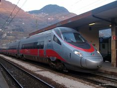 High speed train Frecciargento in Bolzano, Italy  Red silver long fast